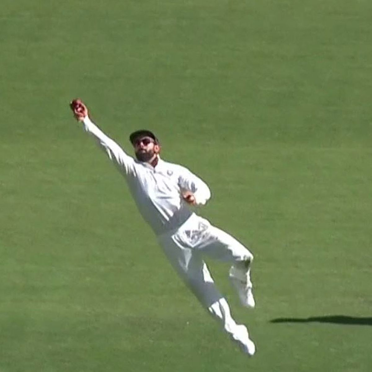 Australia v India: Virat Kohli rivals Usman Khawaja with incredible one-handed diving catch, video