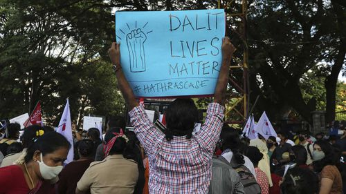 'Dalit Lives Matter' reads a sign at a protest over the death of a 19-year-old woman from the 'untouchable' caste.