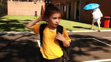 A young girl leaves her school campus in March this year, just before online learning was rolled out across New South Wales.
