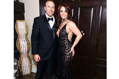 Brunette Britney strikes a pose en route to Elton John's post-Oscars festivities.
