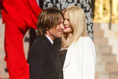 Nicole Kidman and Keith Urban share a moment before the Fall / Winter Haute Couture Fashion Show