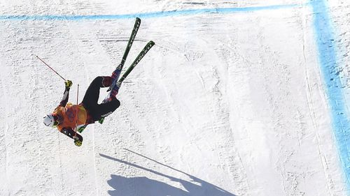 The former world champion slammed into the snow and lay motionless for several minutes. (AAP)