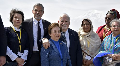 Aurora Prize co-founders, Selection Committee members, finalists, including Hollywood star and rights advocate George Clooney and guests pose in front of Mount Ararat while visiting the Genocide Memorial. (AFP)