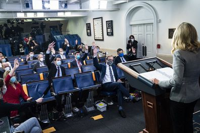 Reporters wearing face masks listen as White House press secretary Kayleigh McEnany at the White on May 08, 2020.