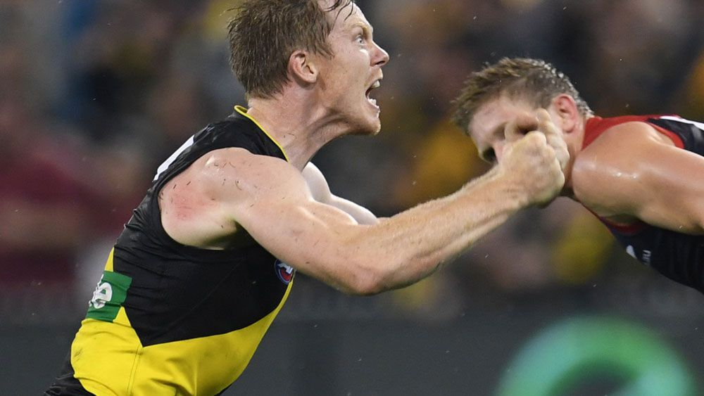 Tigers stun Demons to stay undefeated