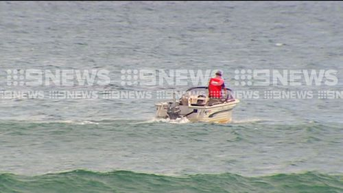 Lifesavers went out in the water to clear swimmers. (9NEWS)