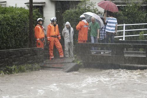 Japanese authorities have directed one million people to evacuate in the south as heavy rains batter the region.