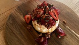 Baked brie with honeyed strawberries, pecan and mint