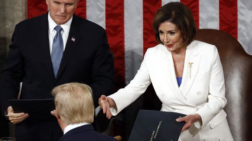 Nancy Pelosi offered her hand to Donald Trump, but he did not take it.
