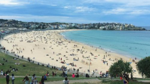 Yesterday's balmy conditions caused hundreds of Sydneysiders to flock to Bondi Beach for a swim in the 'winter heat'. (Instagram)