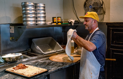 Chef Giovanni Fabiano from Rosa's Pizza, Brooklyn making a Vegemite Pizza for the 'secret menu'.