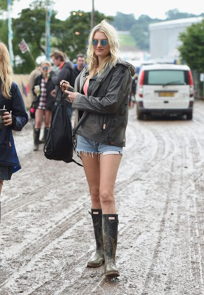 While Coachella was all rainbow hair, wigs and braids, Glastonbury locks have been a lot more low-key, with undone, messy tresses becoming the signature beauty look of the music festival. Day-old blow outs were hidden under hoodies, hats and beanies; laissez-faire buns and ponytails complemented Hunter gumboots; and Alexa Chung, Daisy Lowe and Poppy Delevingne all went for wash and wear styles that only got better with beer, sweat and rain. The message: why spend time in front of the mirror when there is mud and music to get to? Click through to see all the best festival hair.