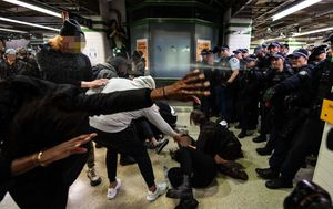 Protests live updates: Man charged after 'scuffle' at Sydney's Central Station; Thousands rally in Washington; Ivanka Trump address cancelled; Two Buffalo police officers charged with assault; Melbourne rally organisers to be fined