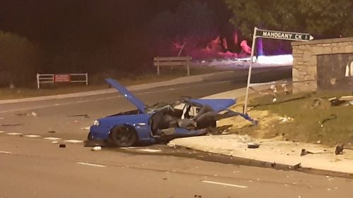 The couple's Skyline was torn in half following the crash.