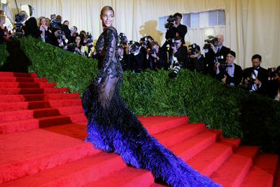 Baby mama looked cool and confident in a sheer Givenchy gown on the red carpet just four months after giving birth.