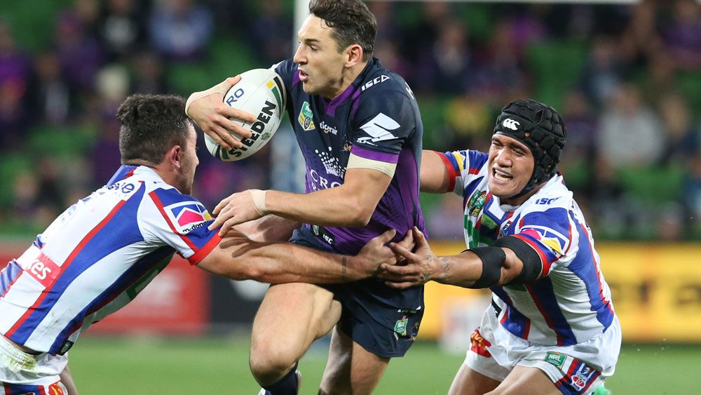Billy Slater takes on the Knights defence at AAMI Park. (AAP)