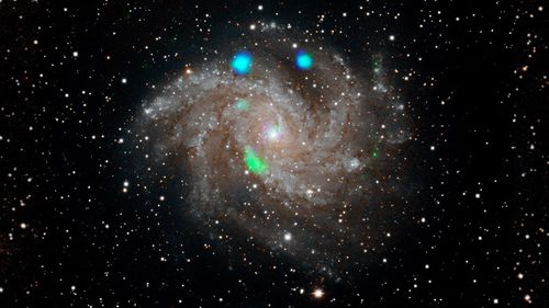Scientists at NASA are perplexed by what made this distant galaxy glow blue and green.