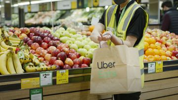 Woolworths and Uber Eats have teamed up promising to deliver fresh groceries in an hour.