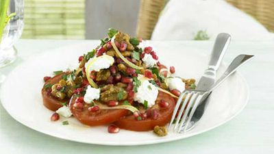 "Click through for our <a href=""http://kitchen.nine.com.au/2016/05/19/12/24/tomato-pomegranate-and-caramelised-walnut-salad"" target=""_top"">tomato, pomegranate and caramelised walnut salad</a> recipe"