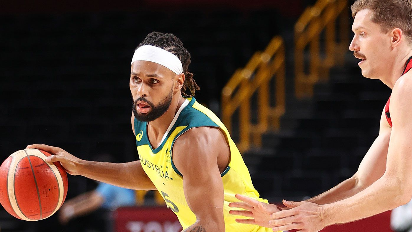 Patty Mills #5 of Team Australia drives to the basket against Germany during the first half of a Men's Basketball Preliminary Round Group B game on day eight of the Tokyo 2020 Olympic Games at Saitama Super Arena on July 31, 2021 in Saitama, Japan. (Photo by Gregory Shamus/Getty Images)