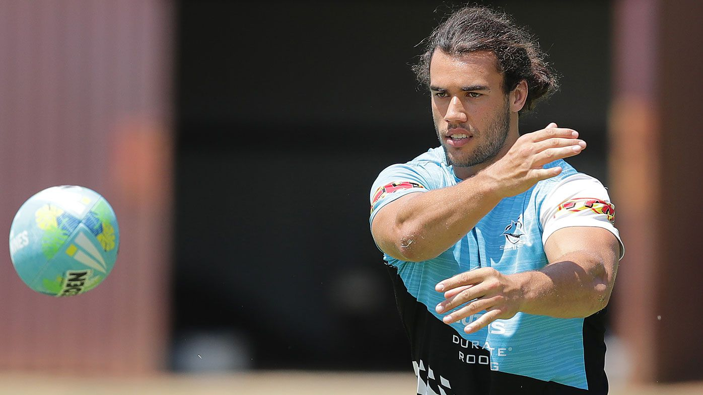Toby Rudolf passes the ball during the Cronulla Sharks NRL training session