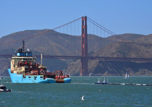 In this file photo, a ship tows The Ocean Cleanup's first buoyant trash-collecting device toward the Golden Gate Bridge in San Francisco en route to the Pacific Ocean
