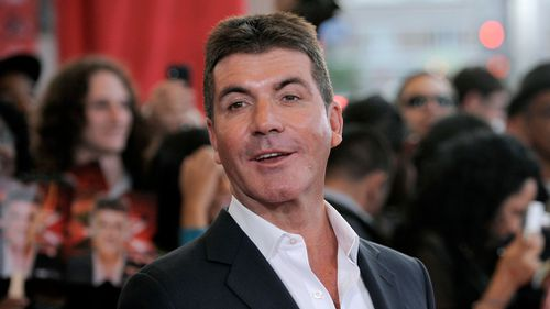 "Simon Cowell, executive producer and a judge on ""The X Factor"", poses at a world premiere screening event for the new television series, in Los Angeles, USA in 2011. (AP)"