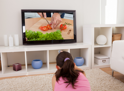 Girl watching a cooking show