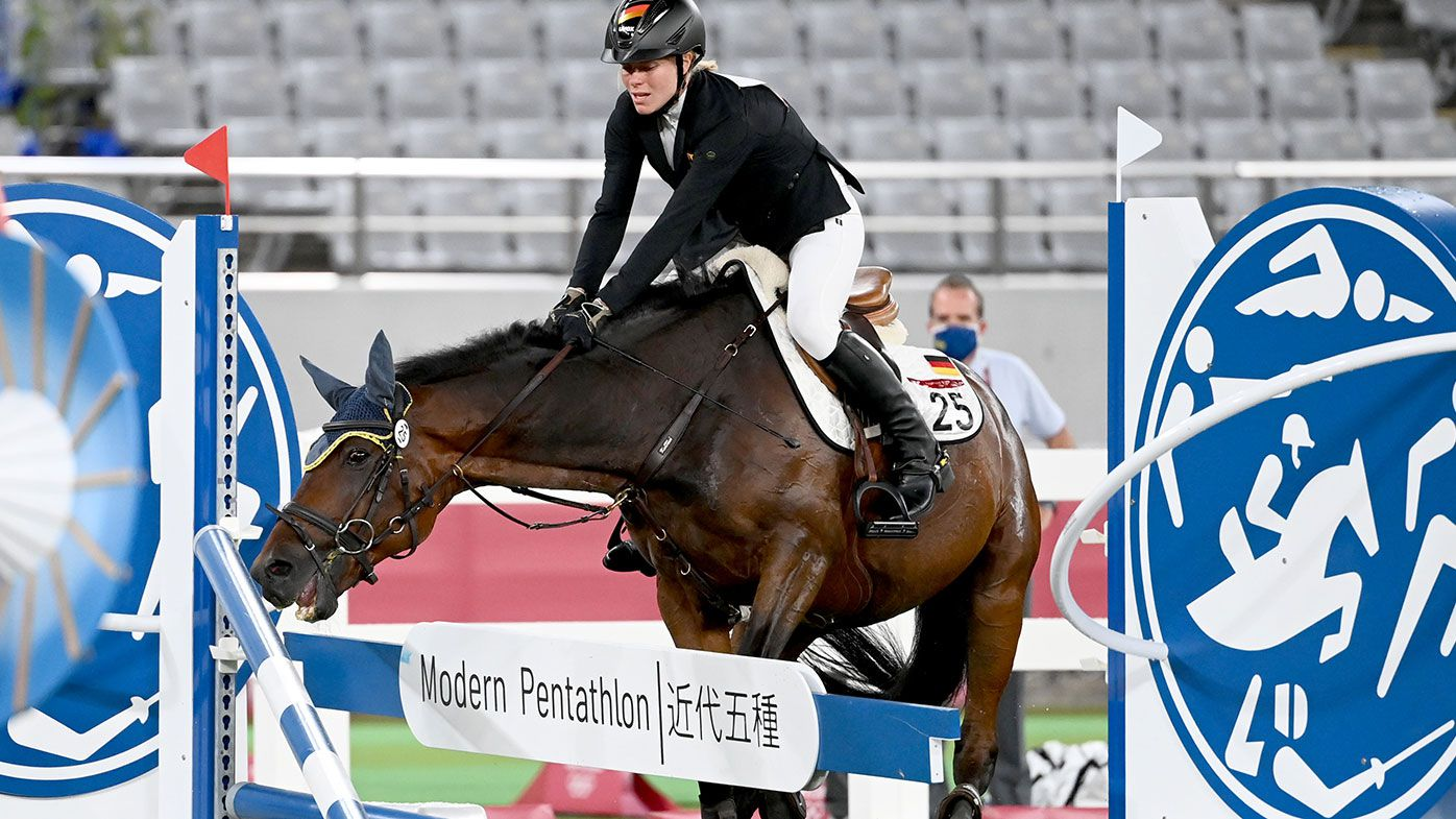 The horse Saint Boy of Annika Schleu from Germany refuses to jump in the Modern Pentathlon at the Tokyo Olympics.