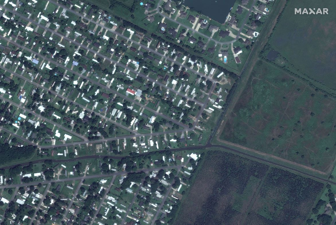 In this before photo, a community of mobile homes along Flounder Drive and Tuna Lane are seen.