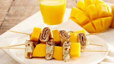 "Recipe: <a href=""http://kitchen.nine.com.au/2018/02/12/14/52/nutella-and-mango-pancake-skewers-recipe"" target=""_top"">Nutella and mango skewer</a>"