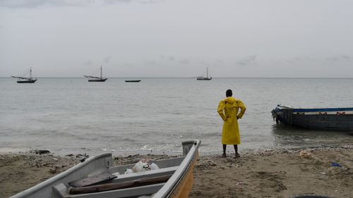 A fisherman looks at the sea in Caira beach, in the Haitian commune of Leogane, on October 3. (AFP)