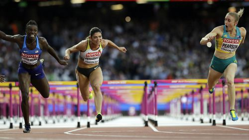 Pearson crosses the line to win the 100m hurdles at the 2017 World Championships in London. (AAP)