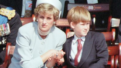 Diana Princess of Wales holding the hand of her son Prince Harry at a ceremony in Hyde Park, London, marking the 50th anniversary of VE Day at the end of World War Two