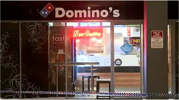Police are investigating after a man held up an Edensor Park Domino's overnight.