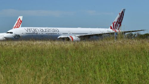 Grounded Qantas and Virgin Australia aircraft are seen parked at Avalon Airport in Melbourne, in April. Government-mandated travel restrictions have grounded a significant proportion of Australia's airline fleet because of the Coronavirus