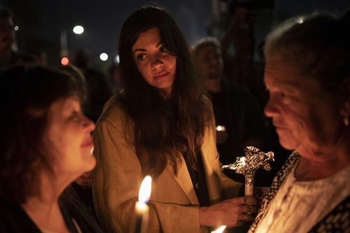 People gather for an interfaith vigil for the victims of the shooting in the Tree of Life Synagogue in Pittsburgh.