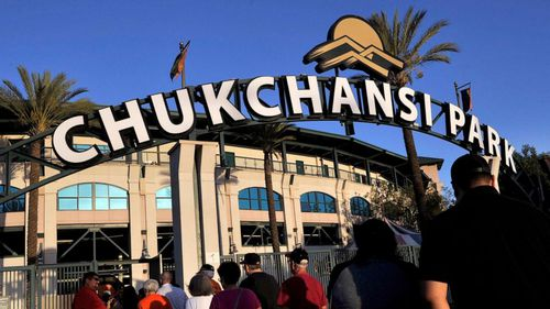Fans arrive at Chukchansi Park in Fresno, Calif., Sept. 18, 2015, for a minor-league baseball game between the Fresno Grizzlies and the Round Rock Express.
