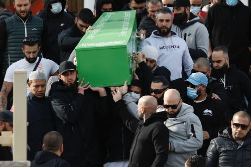 The coffin containing the body of the slain underworld is carried down the front stairs of Lakemba Mosque to an awaiting hearse for transportation to Rookwood Cemetery. Bilal Hamze funeral