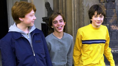 Rupert Grint (L), Emma Watson (C) and Daniel Radcliffe (R) on November 6, 2001, shortly after being cast in 'Philosopher's Stone'. (AAP)