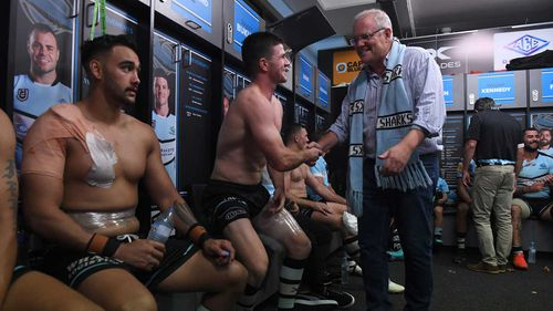 Prime Minister Scott Morrison joined the players in the dressing room following the Sharks win over the Panthers.