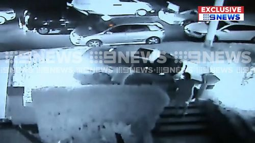 A fifth car can be seen pulling up at the scene. (9NEWS)
