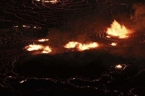 Kilauea's latest eruption is not expected to flow into residential areas. (M. Patrick /USGS via AP)