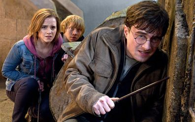 "Actors (from left) Emma Watson, Rupert Grint and Daniel Radcliffe in a scene from ""Harry Potter and the Deathly Hallows: Part 2."" (AAP)"