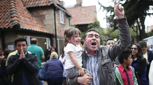 A man reacts to the unfolding referendum results. (AAP)