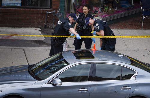 Police are continuing to scour the scene of the shooting. Picture: AAP