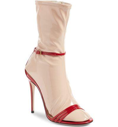 "<p>Who doesn't love a two-in-one time-saver?</p> <p><a href=""https://shop.nordstrom.com/s/gucci-ilse-sock-sandal-women/4579187"" target=""_blank"" draggable=""false"">Gucci Ilse Sock Sandal</a>, $1,590</p>"