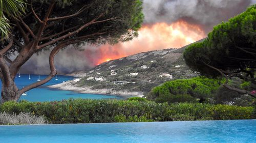 More than 10,000 people have been forced to evacuate because of the blaze. (AFP)