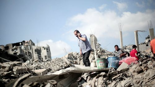 Gaza toll tops 1000 as bodies found during truce