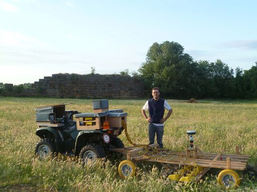 Archaeologists used an all-terrain vehicle to pull their instruments over the land.